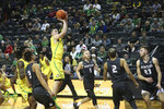 Oregon's Payton Pritchard, center, shoots between several Montana defenders during the second half of an NCAA college basketball game in Eugene, Ore., Wednesday, Dec. 18, 2019. (AP Photo/Chris Pietsch)