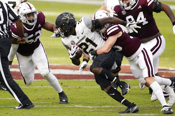 Vanderbilt running back Keyon Henry-Brooks (21) is tackled by a Mississippi State defender during the first half of an NCAA college football game in Starkville, Miss., Saturday, Nov. 7, 2020. (AP Photo/Rogelio V. Solis)