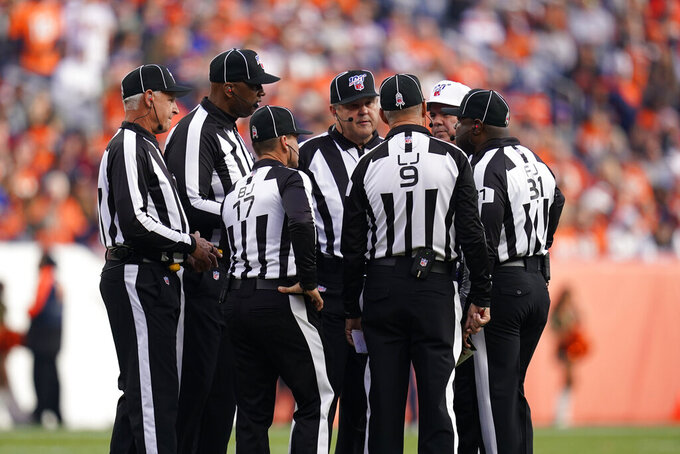 "In this Nov. 3, 2019, file photo, officials discuss a call during the first half of an NFL football game between the Cleveland Browns and the Denver Broncos in Denver. Two teams have suggested changes to game officiating, including a ""sky judge"" utilized by colleges, among seven rules proposals that will be presented to team owners later this month. (AP Photo/Jack Dempsey, File)"