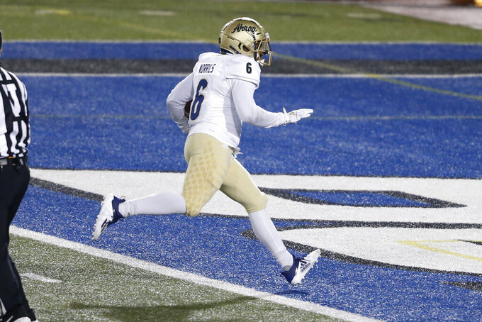 Akron running back Jonzell Norrils (6) runs in for a touchdown during the second half of an NCAA college football game against Buffalo in Amherst, N.Y., Saturday, Dec. 12, 2020. (AP/ Photo Jeffrey T. Barnes)