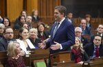 Leader of the Opposition Andrew Scheer turns and speaks to Conservative MP's as he announces he will step down as leader of the Conservatives, Thursday, December 12, 2019 in the House of Commons in Ottawa. (Adrian Wyld/The Canadian Press via AP)