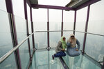 Tourists pose for a photo at Skybox at Kuala Lumpur Tower as city stands shrouded with haze in Kuala Lumpur, Malaysia, Friday, Sept. 13, 2019. Malaysian authorities plan to conduct cloud-seeding activities to induce rain to ease the haze. The government said it will press Jakarta to take immediate action to put out the burning forests and ensure the fires won't occur again. (AP Photo/Vincent Thian)