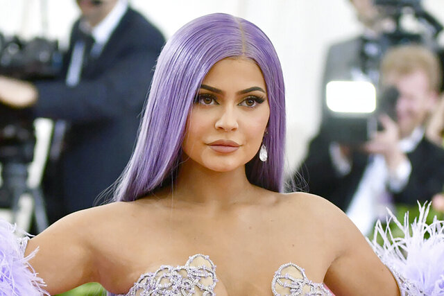 FILE - In this May 6, 2019, file photo, Kylie Jenner attends The Metropolitan Museum of Art's Costume Institute benefit gala in New York. Forbes magazine, which once declared Jenner a billionaire on its cover, says she no longer deserves the title if she ever did, but Jenner is pushing back. Forbes said in a story posted Friday that an examination of financial filings after the reality star and beauty mogul sold 51% of her company Kylie Cosmetics to Coty in a January deal valued at $1.2 billion reveal that Jenner's worth was inflated. (Photo by Charles Sykes/Invision/AP, File)