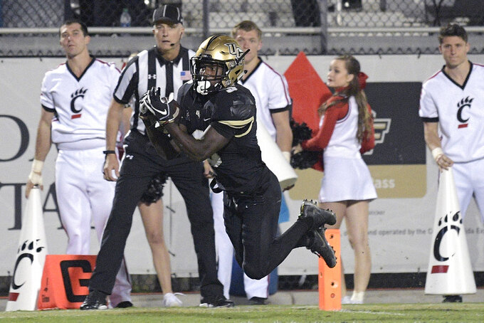 Central Florida running back Adrian Killins Jr. (9) catches a pass in the end zone for a 17-yard touchdown during the first half of an NCAA college football game against Cincinnati Saturday, Nov. 17, 2018, in Orlando, Fla. (AP Photo/Phelan M. Ebenhack)