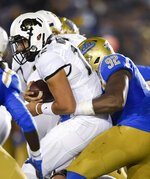 UCLA defensive lineman Osa Odighizuwa, right, sacks Colorado quarterback Steven Montez during the first half of an NCAA college football game in Los Angeles, Saturday, Nov. 2, 2019. (AP Photo/Kelvin Kuo)