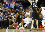 Butler guard Kamar Baldwin (3) drives as Seton Hall guard Shavar Reynolds (33) defends next to Butler's Sean McDermott during the second half of an NCAA college basketball game Wednesday, Feb. 19, 2020, in Newark, N.J. Seton Hall won 74-72. (AP Photo/Kathy Willens)