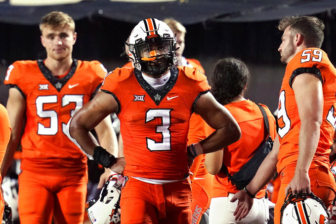 Oklahoma State safety Tre Sterling (3) walks on the sideline during the second half of the team's NCAA college football game against Missouri State, Saturday, Sept. 4, 2021, in Stillwater, Okla. (AP Photo/Sue Ogrocki)