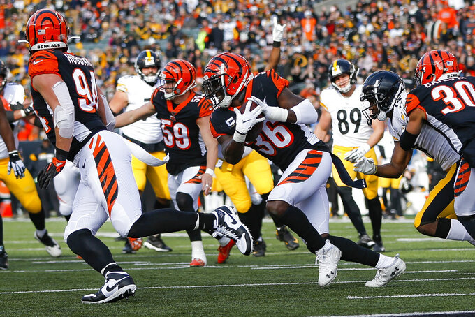 Cincinnati Bengals strong safety Shawn Williams (36) runs the ball after catching an interception off Pittsburgh Steelers quarterback Mason Rudolph (2) during the first half an NFL football game, Sunday, Nov. 24, 2019, in Cincinnati. (AP Photo/Frank Victores)