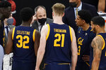 California head coach Mark Fox speaks with his players at a timeout during the second half of an NCAA college basketball game against Stanford in the first round of the Pac-12 men's tournament Wednesday, March 10, 2021, in Las Vegas. (AP Photo/John Locher)
