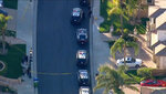 In this still image taken from aerial video provided by KABC-TV, Los Angeles police officers secure a residence in Porter Ranch, northwest of Los Angeles Monday, Feb. 18, 2019. Several people were found dead following reports of gunfire at a home in an upscale gated community. (KABC-TV via AP)