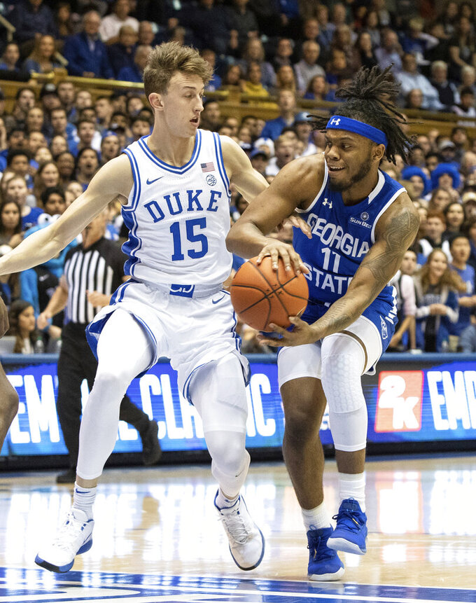 Georgia State's Corey Allen (11) drives against Duke's Alex O'Connell (15) during the first half of an NCAA college basketball game in Durham, N.C., Friday, Nov. 15, 2019. (AP Photo/Ben McKeown)