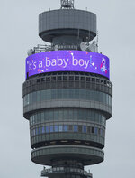 The BT Tower displays a message in celebration of the birth of Prince Harry, and Meghan, the Duchess of Sussex's new baby boy, in London, Monday May 6, 2019. (Yui Mok/PA via AP)