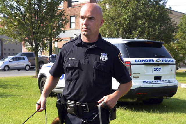 FILE - This Sept, 9, 2015 file photo shows Officer Sean McKown outside the Cohoes Police Station, in Cohoes, N.Y. Amid pressure from activists and community leaders, a prosecutor has asked New York State Police for the case file on an incident in which the off-duty police officer claimed he had been shot at by a group of Black people. Activists and community leaders delivered a letter to Essex County District Attorney Kristy Sprague last week demanding a full investigation of the June 6 incident involving McKown. McKown initially reported he had confronted a group of Black youths outside his summer home in the Adirondacks. He is now retiring amid suspicions that he made the story up. (John Carl D'Annibale/The Albany Times Union via AP, File)