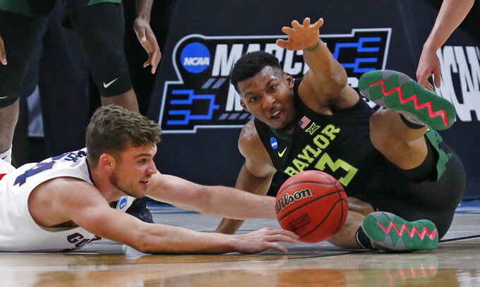 Baylor guard King McClure (3) and Gonzaga forward Corey Kispert (24) reach for the ball during the first half of a second-round game in the NCAA men's college basketball tournament Saturday, March 23, 2019, in Salt Lake City. (AP Photo/Rick Bowmer)