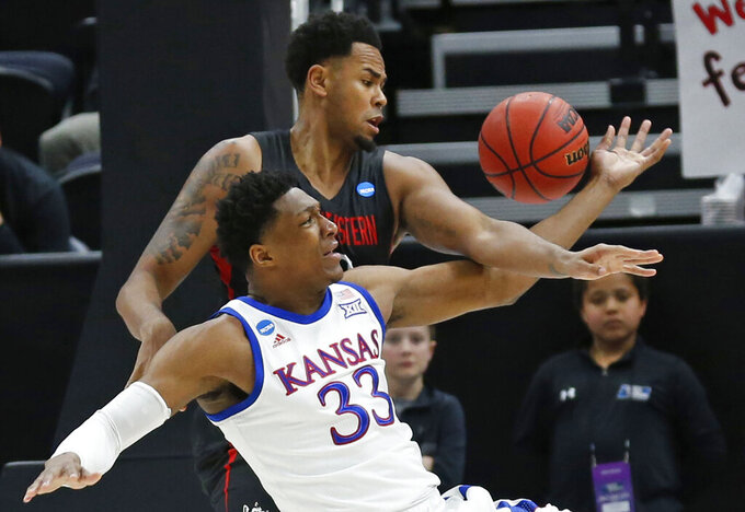 Northeastern center Anthony Green, rear, and Kansas guard Ochai Agbaji (30) battle for the ball in the first half during a first round men's college basketball game in the NCAA Tournament, Thursday, March 21, 2019, in Salt Lake City. (AP Photo/Rick Bowmer)