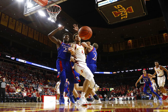 Iowa State forward George Conditt IV (4) and Kansas forward Silvio De Sousa (22) watch the ball get away during the second half of an NCAA college basketball game Wednesday, Jan. 8, 2020, in Ames, Iowa. Kansas won 79-53. (AP Photo/Charlie Neibergall)