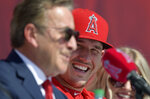 Los Angeles Angels owner Arte Moreno, left, speaks as center fielder Mike Trout listens during a news conference to talk about Trout's 12-year, $426.5 million contract, prior to the team's exhibition baseball game against the Los Angeles Dodgers on Sunday, March 24, 2019, in Anaheim, Calif. (AP Photo/Mark J. Terrill)