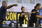 Conleth Hill, from left, Maisie Williams and Jacob Anderson throw their name card to the audience at the conclusion of the