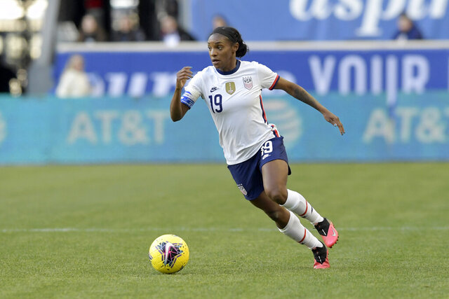 FILE - In this March 8, 2020, file photo, United States defender Crystal Dunn, who plays for the North Carolina Courage of the National Women's Soccer League, plays during the first half of a SheBelieves Cup soccer match against Spain, in Harrison, N.J. The NWSL opens its Challenge Cup tournament on Saturday, June 27, 2020, and the pressure is on as the first professional team sport in the United States to play amid the coronavirus pandemic. (AP Photo/Bill Kostroun, File)