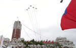 Thunder Tiger Aerobatics Team fly over President Office during the National Day celebrations in Taipei, Taiwan, Saturday, Oct. 10, 2020. Taiwanese President Tsai Ing-wen said Saturday she has hopes for less tensions with China and in the region if Beijing will listen to Taipei's concerns, alter its approach and restart dialogue with the self-ruled island democracy.  (AP Photo/Chiang Ying-ying)