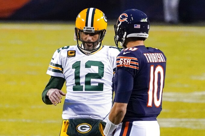 Green Bay Packers' Aaron Rodgers talks to Chicago Bears' Mitchell Trubisky durinfg a break in the action during the first half of an NFL football game Sunday, Jan. 3, 2021, in Chicago. (AP Photo/Nam Y. Huh)