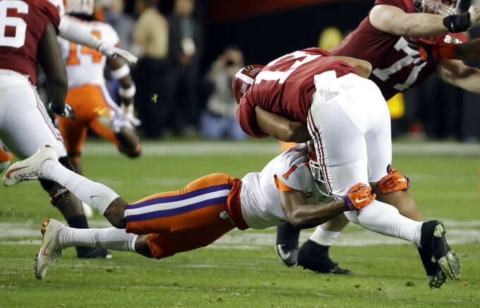 Alabama's Tua Tagovailoa is sacked by Clemson's Trayvon Mullen during the first half of the NCAA college football playoff championship game Monday, Jan. 7, 2019, in Santa Clara, Calif. (AP Photo/Chris Carlson)