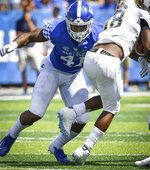 Kentucky linebacker Josh Allen (41) tackles Murray State wide receiver Rodney Castille (18) during the second half an NCAA college football game in Lexington, Ky., Saturday, Sept. 15, 2018. (AP Photo/Bryan Woolston)