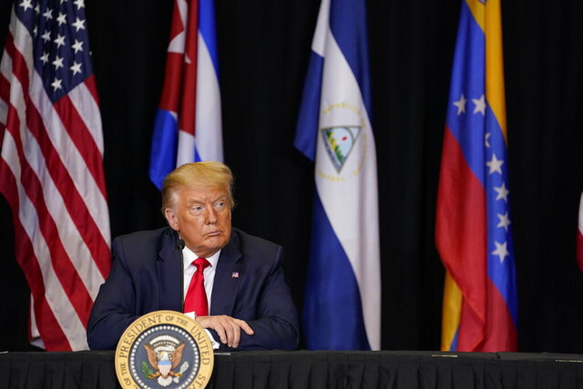 President Donald Trump listens during a roundtable on Venezuela at Iglesia Doral Jesus Worship Center, Friday, July 10, 2020, in Doral, Fla. (AP Photo/Evan Vucci)