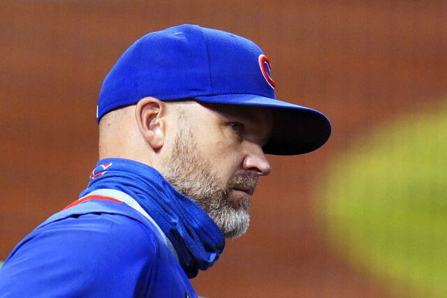 Chicago Cubs manager David Ross stands in the dugout during the first inning of the team's baseball game against the Pittsburgh Pirates in Pittsburgh, Wednesday, Sept. 23, 2020. (AP Photo/Gene J. Puskar)