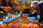 Ofelia Esparza, 88, from East Los Angeles, arranges fresh marigolds, often called
