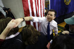 Democratic presidential candidate former South Bend, Ind., Mayor Pete Buttigieg, center right, greets people in the audience at the conclusion of a campaign rally, Sunday, Feb. 9, 2020, in Dover, N.H. (AP Photo/Steven Senne)