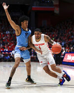Rhode Island's Jeff Dowtin defends against Dayton's Obi Toppin during the first half of an NCAA college basketball game, Tuesday, Feb. 11, 2020, in Dayton, Ohio. (AP Photo/Aaron Doster)