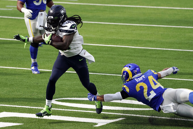 Seattle Seahawks running back Alex Collins, right, runs for a touchdown past Los Angeles Rams safety Taylor Rapp (24) during the first half of an NFL football game Sunday, Nov. 15, 2020, in Inglewood, Calif. (AP Photo/Jae C. Hong)