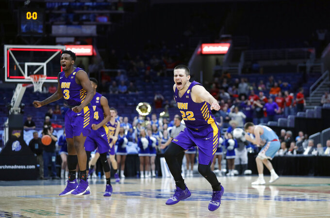 Northern Iowa's Wyatt Lohaus (22) and Tywhon Pickford (3) celebrate as the final horn sounds at the end of an NCAA college basketball game against Drake in the semifinal round of the Missouri Valley Conference tournament, Saturday, March 9, 2019, in St. Louis. Lohaus hit a basket with seconds left to give Northern Iowa a 60-58 victory. (AP Photo/Jeff Roberson)