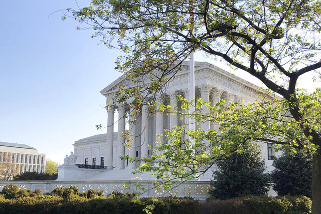 The Supreme Court is shown, Monday, April 6, 2020 in Washington. The Supreme Court on Monday rejected an appeal from the Catholic church in Washington, DC, that sought to place religious-themed ads on public buses.  (AP Photo/Mark Sherman)