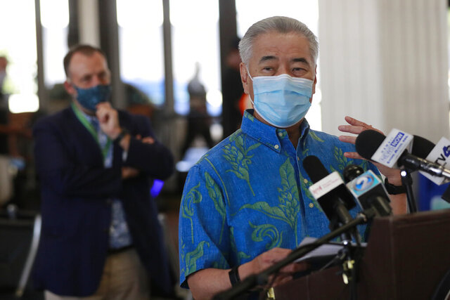 FILE - In this Oct. 15, 2020, file photo, Hawaii Gov. David Ige speaks at a news conference at the Daniel K. Inouye International Airport in Honolulu. On Monday, Jan. 25, 2021, Ige asked residents to be ready for more tough times ahead as the state grapples with a large budget shortfall caused by a coronavirus pandemic that's pummeled the tourism industry, but said improved tax revenue forecasts mean he's not currently seeking broad-based tax increases. (AP Photo/Marco Garcia, File)