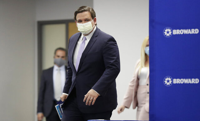 Florida Gov. Ron DeSantis arrives at a news conference, Monday, Aug. 3, 2020, at the Broward Health Corporate Office in Fort Lauderdale, Fla. On Friday, the governor's office released a video promoting