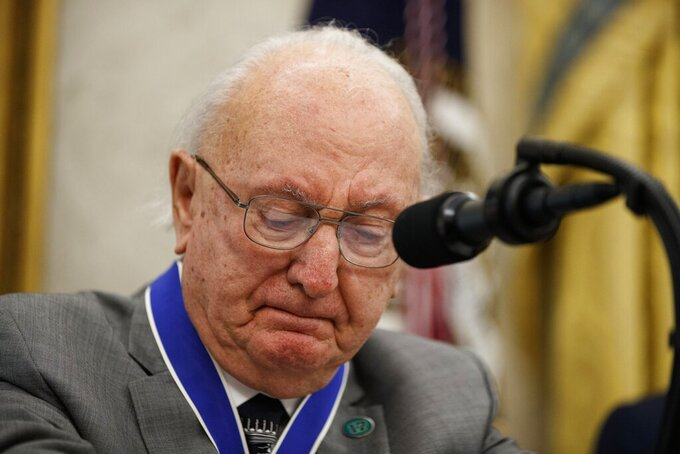 Former NBA basketball player and coach Bob Cousy, of the Boston Celtics, pauses while speaking as President Donald Trump stands, during a Presidential Medal of Freedom ceremony for Cousy, in the Oval Office of the White House, Thursday, Aug. 22, 2019, in Washington. (AP Photo/Alex Brandon)