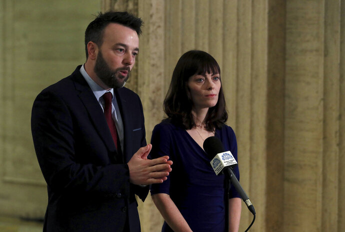SDLP or Social Democratic and Labour Party leader Colum Eastwood, left and deputy leader Nichola Mallon speak to the media in the Great Hall of Parliament Buildings, Stormont, in Belfast, Northern Ireland, Friday, Jan. 10, 2020.  Northern Ireland's main political parties met on Friday to decide whether to accept a deal to restore the Belfast-based government that collapsed three years ago. (Brian Lawless/ PA via AP)