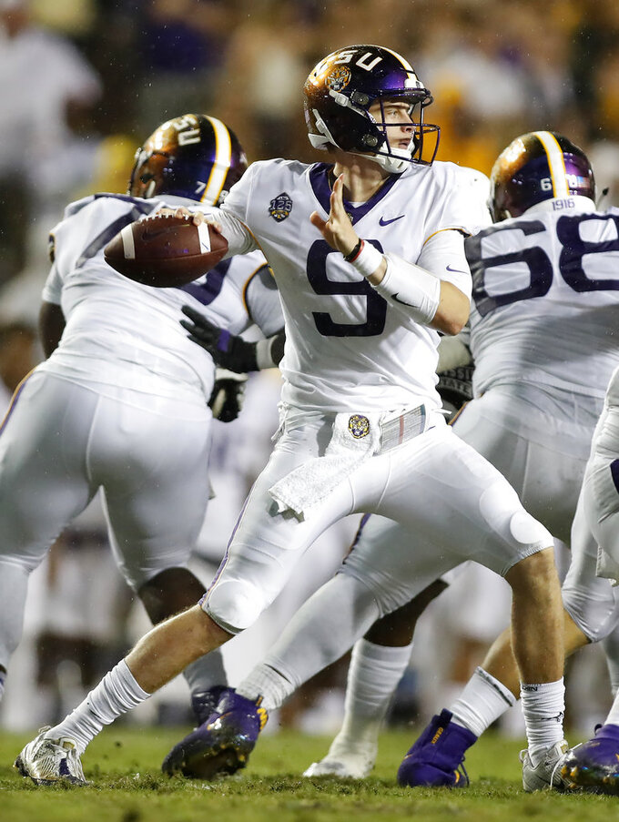 LSU quarterback Joe Burrow (9) throws the ball during an NCAA college football game against Mississippi State in Baton Rouge, La., Saturday, Oct. 20, 2018. (AP Photo/Tyler Kaufman)