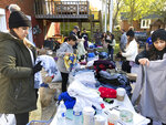 In this Nov. 9, 2019, photo, members of the Kurdish community and supporters pack clothing donations in Nashville, Tenn. The items are being sent to a camp in Iraq where many Kurds have fled from Syria. Nashville lays claim to the largest diaspora of Kurds in the U.S., and many of them say President Donald Trump betrayed the Kurdish people through the withdrawal of troops from northern Syria. (AP Photo/Jonathan Mattise)