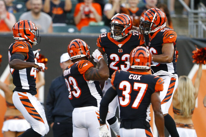 Cincinnati Bengals cornerback Darius Phillips (23) celebrates his interception during the first half of the team's NFL preseason football game against the Indianapolis Colts, Thursday, Aug. 29, 2019, in Cincinnati. (AP Photo/Gary Landers)