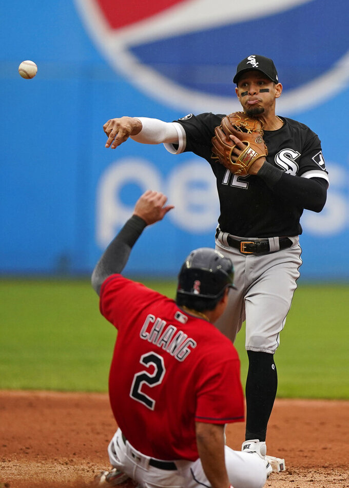 Chicago White Sox's Cesar Hernandez (12) gets Cleveland Indians' Yu Chang (2) at second base in the fourth inning in the first baseball game of a doubleheader, Thursday, Sept. 23, 2021, in Cleveland. Harold Ramirez was out at first base for the double play. (AP Photo/Tony Dejak)