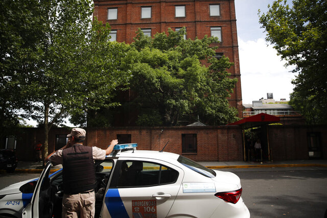 A police officer stands in front of the Faena Art Hotel in Buenos Aires, Argentina, hours after assailants trying to rob two British tourists shot and killed one of them and wounded the other, Saturday, Dec. 14, 2019 (AP Photo/Natacha Pisarenko)