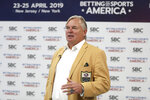 FILE - In this April 25, 2019, file photo, New Orleans Saints NFL football kicker and Hall of Fame enshrinee Morten Andersen is interviewed during the Betting On Sports America conference, in Secaucus, N.J. As sports betting spreads across the country, the NFL is all in on a business it long considered its biggest threat. (AP Photo/Julio Cortez, File)