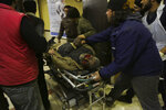 A man wounded in airstrikes is brought to a hospital in the city of Idlib, Syria, Wednesday, Jan. 15, 2020. Syrian government warplanes struck a market and an industrial area Wednesday in the last territory in the hands of rebel groups in the country's northwest, killing at least 15 people, opposition activists said. (AP Photo/Ghaith Alsayed)