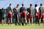 Tampa Bay Buccaneers quarterback Tom Brady, third from left, joins his teammates at midfield during NFL football training camp, Tuesday, Aug. 4, 2020, in Tampa. (Douglas R. Clifford/Tampa Bay Times via AP)