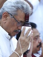 FILE- In this Aug 15, 2019, file photo, former Sri Lankan Defense Secretary and presidential candidate of the country's opposition Gotabaya Rajapaksa prays at a Buddhist temple during his election campaign in Anuradhapura, Sri Lanka. Sri Lanka's newly elected president, Gotabaya Rajapaksa, may struggle to consolidate his victory. With many executive powers clipped and a powerful opposition in control of Parliament, it's unclear when and how Rajapaksa will be able to form a government. (AP Photo/Sajeewa Chinthaka, File)