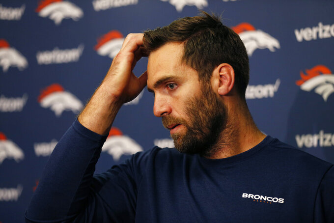Denver Broncos quarterback Joe Flacco answers questions during a news conference at the end of an NFL football game against the Oakland Raiders Monday, Sept. 9, 2019, in Oakland, Calif. Oakland won the game 24-16. (AP Photo/D. Ross Cameron)