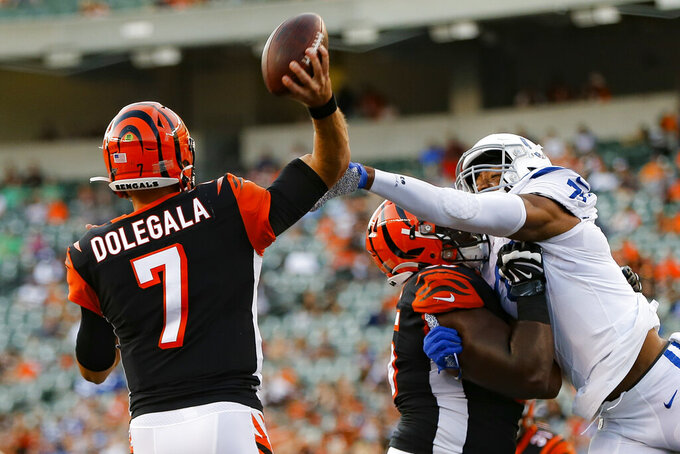 Cincinnati Bengals quarterback Jake Dolegala (7) passes under pressure from Indianapolis Colts defensive tackle Caraun Reid (75) during the first half of an NFL preseason football game Thursday, Aug. 29, 2019, in Cincinnati. (AP Photo/Frank Victores)